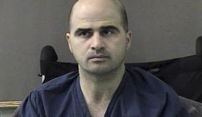 **FILE** Maj. Nidal Hasan is seen April 9, 2010, at the San Antonio to Bell County Jail in Belton, Texas. (Associated Press/Bell County Sheriff's Department)
