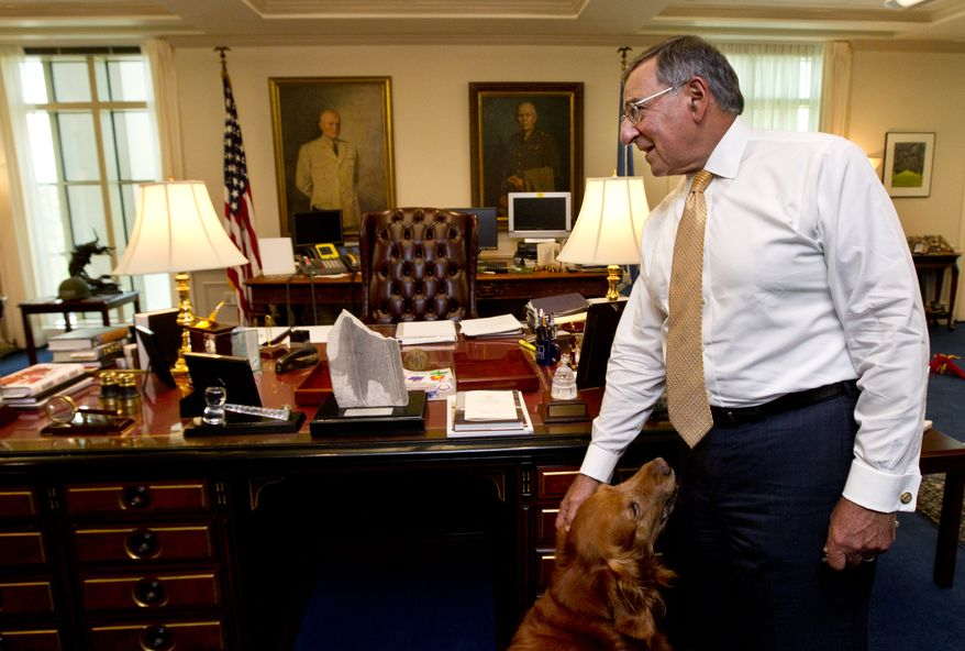 Defense Secretary Leon Panetta, seen here with his golden retriever dog Bravo at the Pentagon, conducts an interview with the Associated Press on Aug. 13, 2012. (Associated Press)