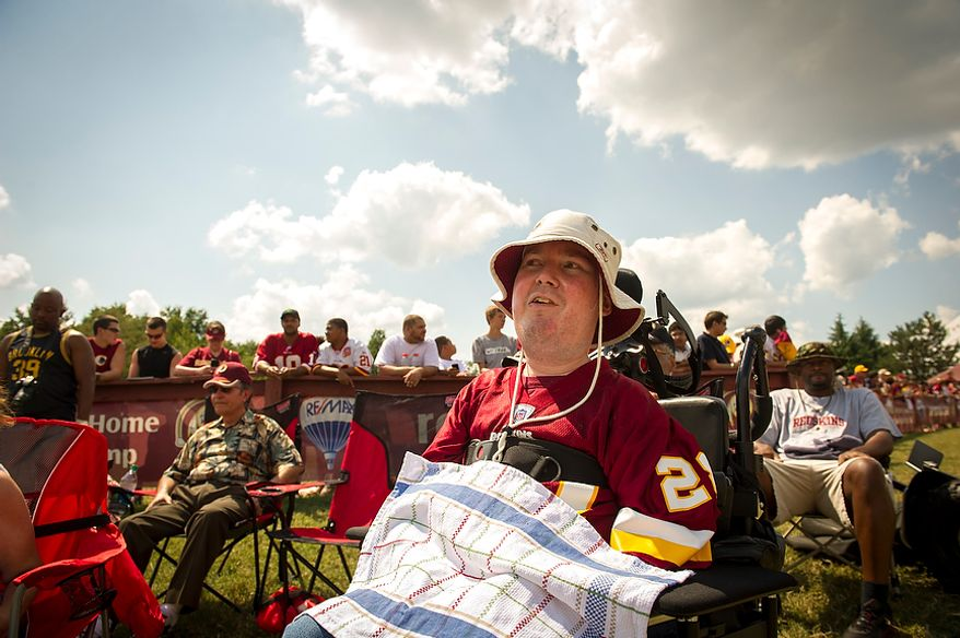 Lewis Beatty, of Hope, NJ, catches the action from the sideline during the Redskins training camp at Redskins Park in Ashburn, Va., Monday, August 13, 2012. (Rod Lamkey Jr./The Washington Times)