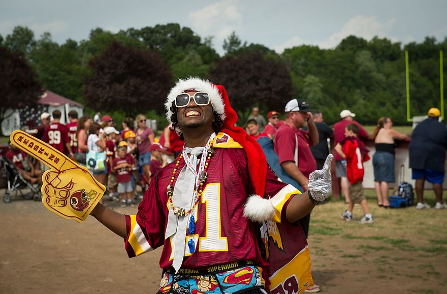 Redskins fan Mike Fields, of Catlett, Va., poses for the camera during Redskins training camp at Redskins Park in Ashburn, Va., Tuesday, August 14, 2012. This is the last day that fans will be able to watch their team practice in this area. Next year the Redskins will move their practice facility to the Richmond, Va., area. (Rod Lamkey Jr./The Washington Times)