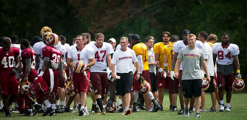 Redskins coach Mike Shanahan (center) makes his exit from the field following Redskins training camp at Redskins Park in Ashburn, Va., Tuesday, August 14, 2012. The Redskins will whittle their roster down to 53 on Friday by 9 p.m. (Rod Lamkey Jr./The Washington Times)
