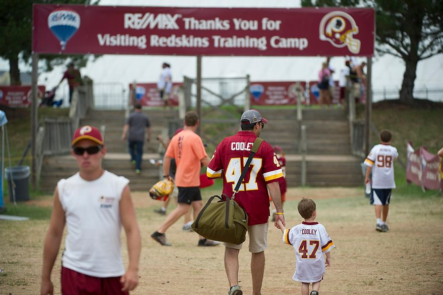 People make their exit following Redskins training camp at Redskins Park in Ashburn, Va., Tuesday, August 14, 2012. This is the last day that fans will be able to watch their team practice in this area. Next year the Redskins will move their practice facility to the Richmond, Va., area. (Rod Lamkey Jr./The Washington Times)