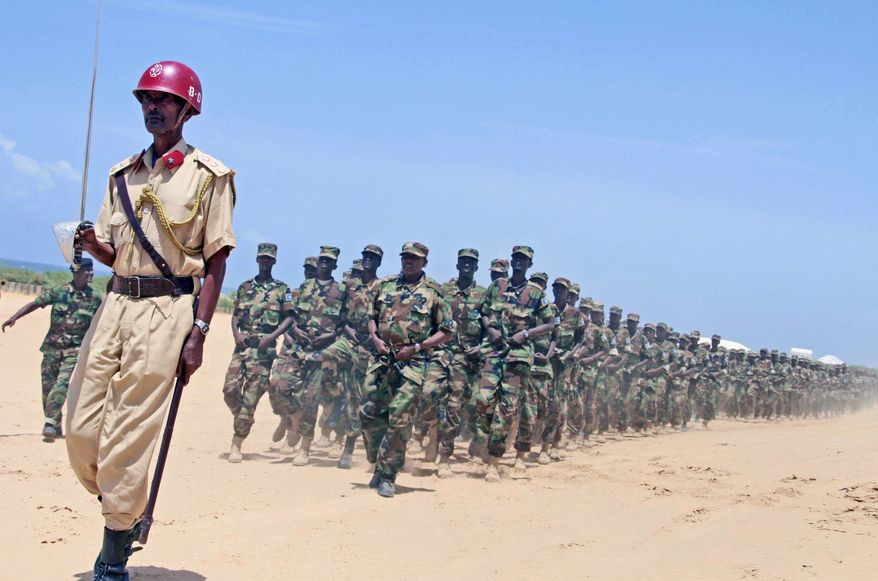 Somali military trainees march Aug. 14, 2012, during a graduation ceremony at the Jazeera military camp on the outskirts of Mogadishu, Somalia. These soldiers are part of 602 trainees who are graduating following an eight-month training program. (Associated Press)