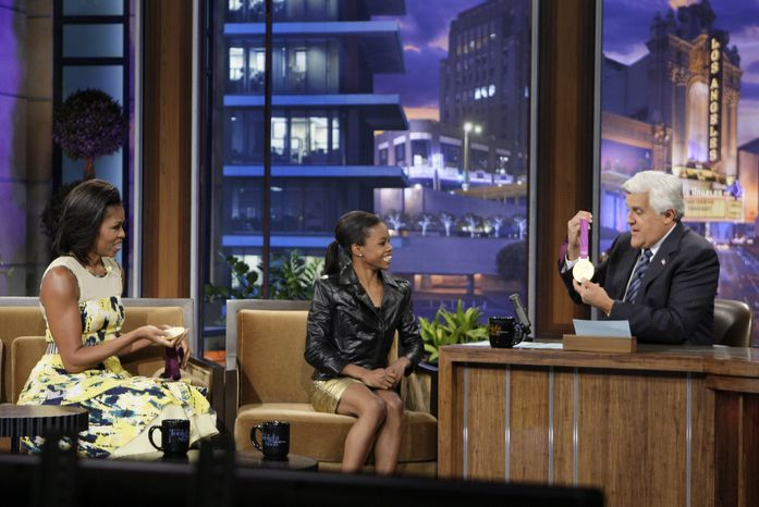 """First lady Michelle Obama (left) and Olympic gold medalist Gabby Douglas appear with host Jay Leno during a taping of """"The Tonight Show With Jay Leno"""" in Burbank, Calif., on Monday, Aug. 13, 2012. (AP Photo/NBC, Margaret Norton)"""