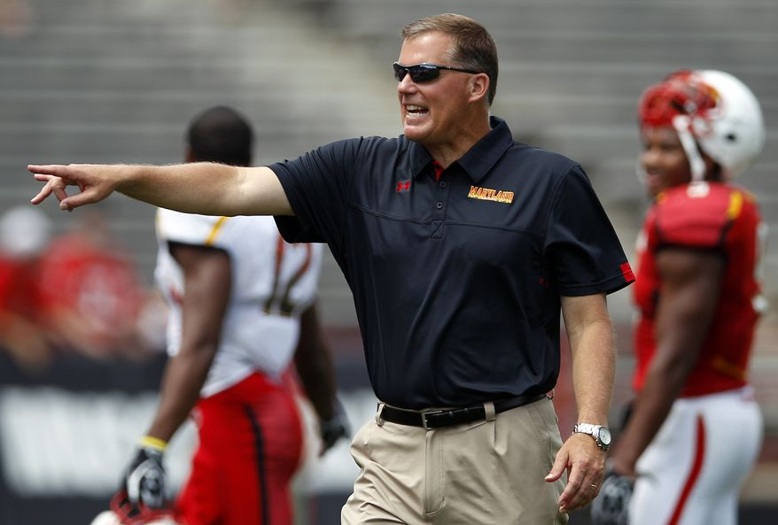 Maryland head coach Randy Edsall directs his players during the team's annual Red-White spring NCAA college football scrimmage in College Park, Md., Saturday, April 21, 2012. (AP Photo/Patrick Semansky)