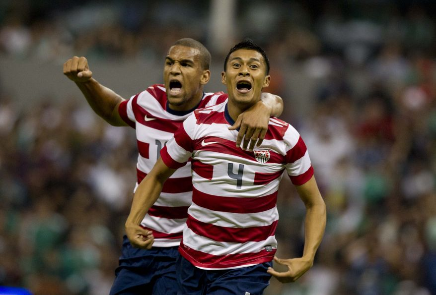 U.S Michael Orozco, right, celebrates with teammate Terrence Boyd after scoring after scoring during a friendly soccer game against Mexico in Mexico City, Wednesday, Aug. 15, 2012. (AP Photo/Eduardo Verdugo)