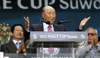 ** FILE ** The Rev. Sun Myung Moon, the founder of the Unification Church, speaks during the opening ceremony of the 2012 Peace Cup Suwon at Suwon World Cup Stadium in Suwon, South Korea, Thursday, July 19, 2012. (AP Photo/Ahn Young-joon)