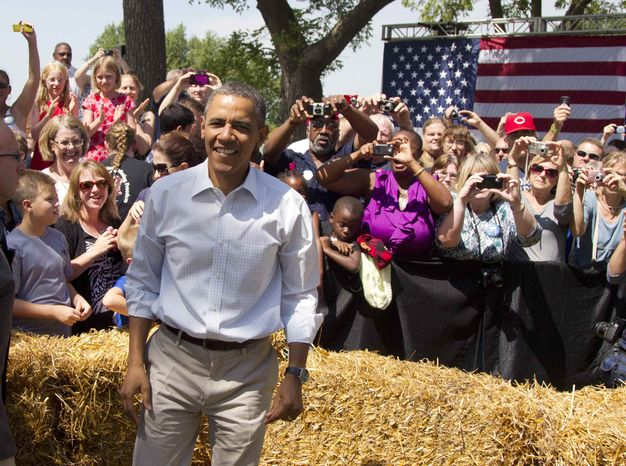 President Barack Obama attends a campaign event at the Nelson Pioneer Farm & Museum, Tuesday, Aug. 14, 2012, in Oskaloosa, Iowa, during a three-day campaign bus tour through Iowa. (AP Photo/Carolyn Kaster)