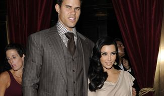 ** FILE ** Kim Kardashian and Kris Humphries attend a party in their honor at Capitale in New York on Wednesday, Aug. 31, 2011. (AP Photo/Evan Agostini)