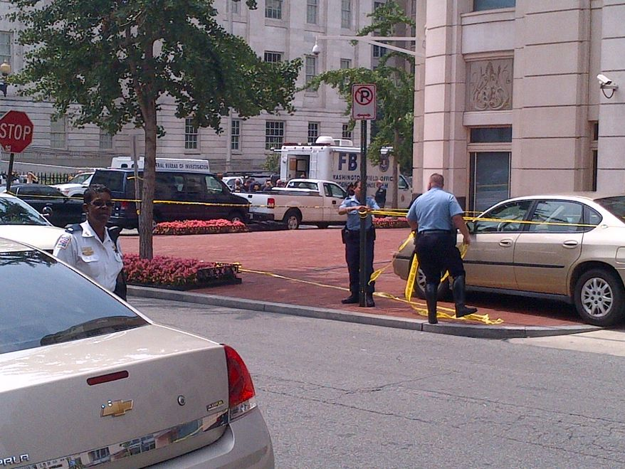Police cordon off an area around the D.C. offices of the Family Research Council, where a security guard was shot Wednesday (Tom Howell Jr./The Washington Times)