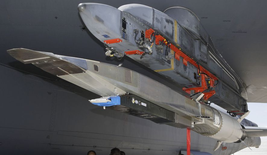 An X-51A Waverider hypersonic flight test vehicle is uploaded to an Air Force Flight Test Center B-52 for fit testing at Edwards Air Force Base in California in July 2009. (Associated Press) ** FILE **