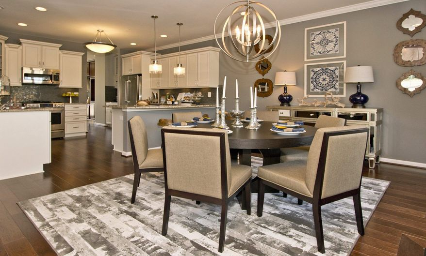 The kitchen in the Chandelier model at the Pointe at ArundelPreserve features 42-inch cabinets and a pantry.