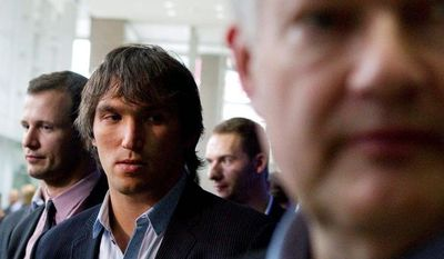 associated press  Washington Capitals captain Alex Ovechkin looks on as NHLPA executive director Donald Fehr talks to reporters after meetings with the league's bargaining unit.