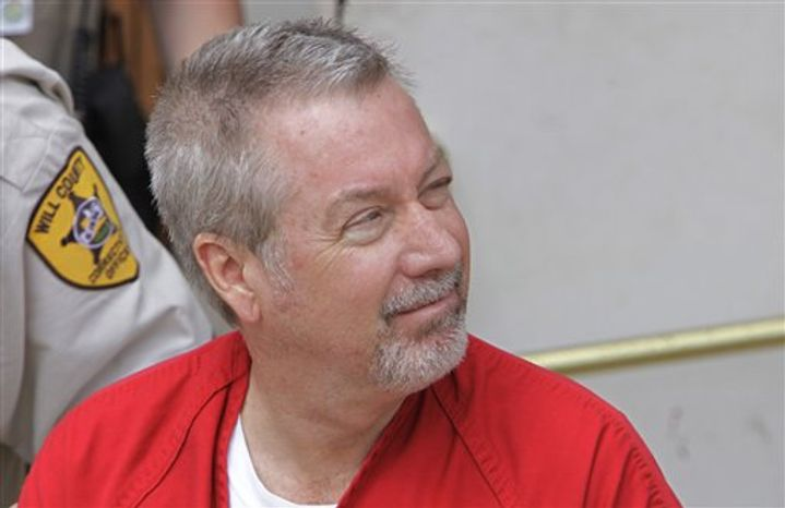 **FILE** Former Bolingbrook, Ill., police officer Drew Peterson leaves the Will County Courthouse in Joliet, Ill., on May 8, 2009, after his arraignment on charges of first-degree murder in the 2004 death of his third wife, Kathleen Savio. (Associated Press)