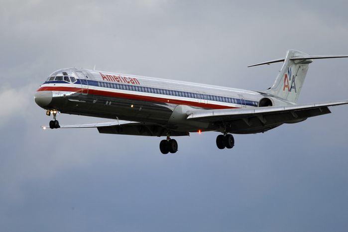 ** FILE ** An American Airlines jetliner approaches Philadelphia International Airport in October 2010.  (AP Photo/Matt Rourke)