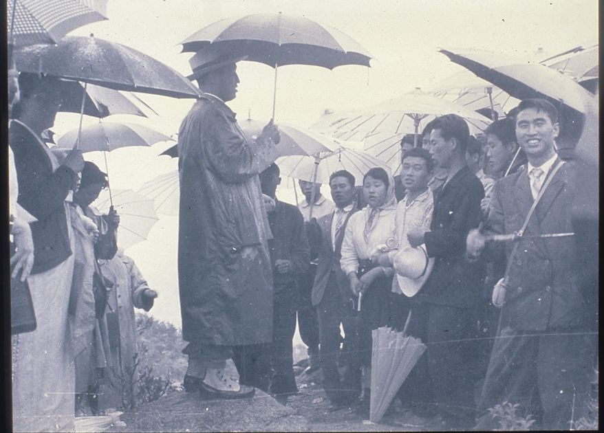 The Rev. Sun Myung Moon with disciples. Courtesy H.S.A.-U.W.C.