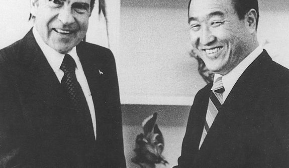 "The Rev. Sun Myung Moon shakes hands with President Richard M. Nixon on Feb 1, 1974. During the heart of the Watergate scandal, Moon bought newspaper ads asking Americans to ""Forgive, Love and Unite"" for the sake of a stronger country. Courtesy H.S.A.-U.W.C."