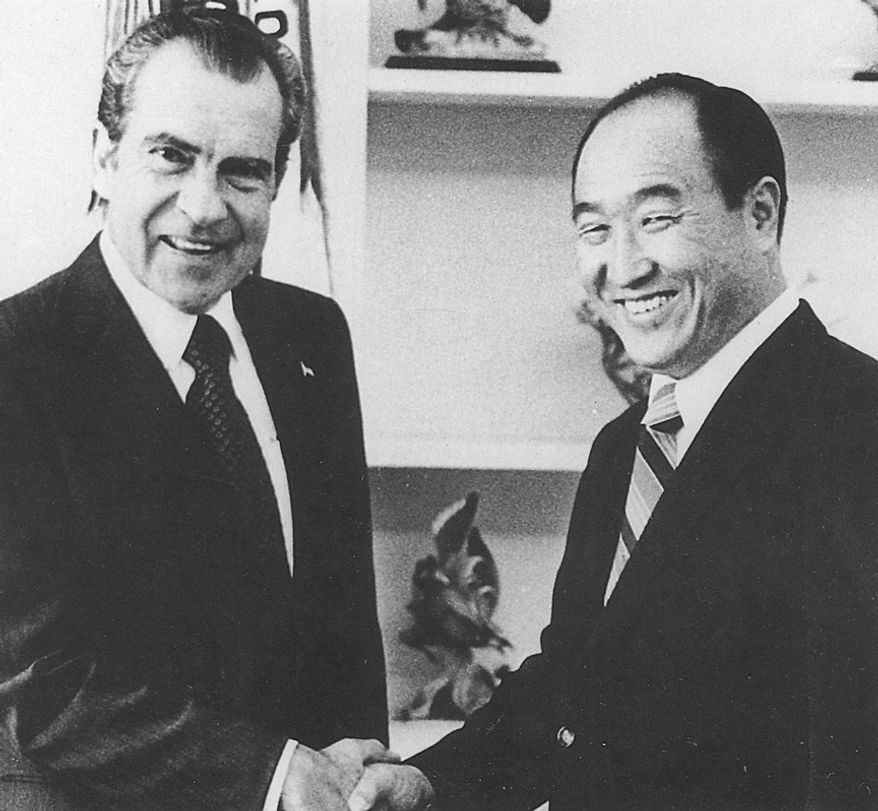"""The Rev. Sun Myung Moon shakes hands with President Richard M. Nixon on Feb 1, 1974. During the heart of the Watergate scandal, Moon bought newspaper ads asking Americans to """"Forgive, Love and Unite"""" for the sake of a stronger country. Courtesy H.S.A.-U.W.C."""