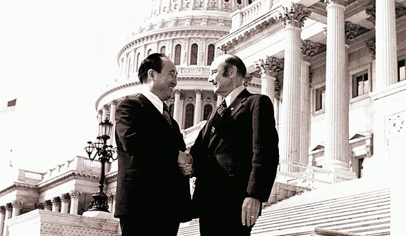 The Rev. Sun Myung Moon shakes hands with Sen. Strom Thurmond, S.C. Courtesy H.S.A.-U.W.C.