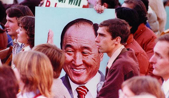Disciples of The Rev. Sun Myung Moon during a rally in the United States. Courtesy H.S.A.-U.W.C.