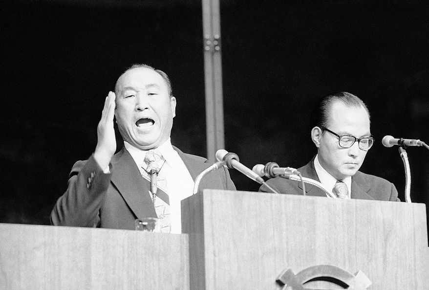 The Rev. Sun Myung Moon standing in front of a protective screen, gestures with his body during his sermon at night on Wednesday, Sept. 18, 1974 at New Yorkís Madison Square Garden. The sermon was the climax of the Korean Evangelistís New York Crusade. (AP Photo/RP)