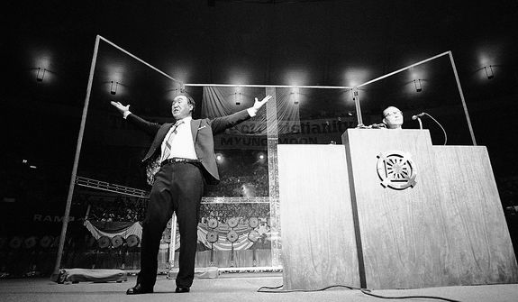 The Rev. Sun Myung Moon gestures to capacity crowd of 2000 on Wednesday, Sept. 19, 1974 in New Yorkís Madison Square Garden, where he preached for the rebirth of Christianity. His appearance was part of a 40-city U.S. tour this year. (AP Photo/RP)