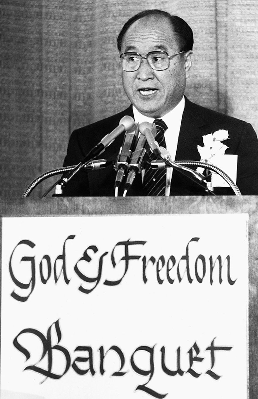 The Rev. Sun Myung Moon speaks at a dinner in his honor in Washington, Aug. 21, 1985. The Korean-born evangelist, who was released on Tuesday after serving a prison sentence for tax evasion, said he was not bitter about his conviction and imprisonment and that it gave him an opportunity for prayer and meditation. (AP Photo/Ron Edmonds)