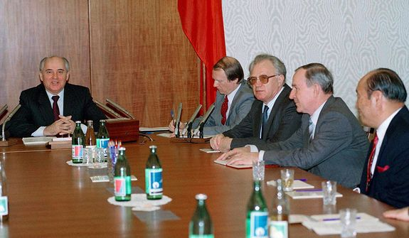 President Mikhail Gorbachev meets the world media group in St. Catherine Hall in Kremlin in Moscow on April 11, 1990. On the first right is Rev. Sun Myung Moon who leads the group that included many former state leaders gathered to hear Gorbachev assessment of the progress of ìperestroikaî policy. (AP Photo/Liu Heung Shing)