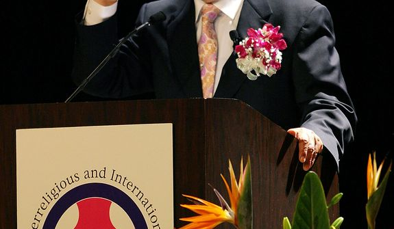 "Unification Church leader Rev. Sun Myung Moon speaks during his ""Now is God's Time"" rally in New York, Saturday, June 25, 2005. Billy Graham is also is hosting a religious event in New York this weekend.   (AP Photo/John Marshall Mantel)"