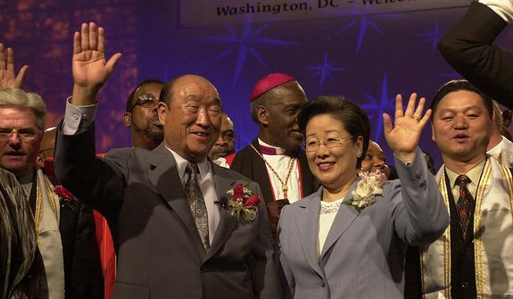 "The Rev. Sun Myung Moon and his wife, Hak Ja Han Moon, are greeted on April 16, 2001, by clergy and worshippers at the We Will Stand 2001 National Tour, held at the Omni Shoreham Regency Hotel in Washington. The theme of the 52-day, 52-city tour was ""Rebuild the Family, Restore the Community, Renew the Nation and the World."" (The Washington Times )"