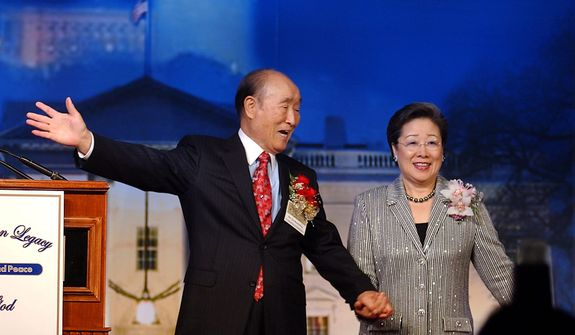 Rev. Sun Myung Moon and Mrs. Sun Myung Moon meet on stage during the Common Legacy Breakfast Summit in Washington, D.C. Monday, December 13, 2004. ( Photo by Daniel Rosenbaum / The Washington Times )