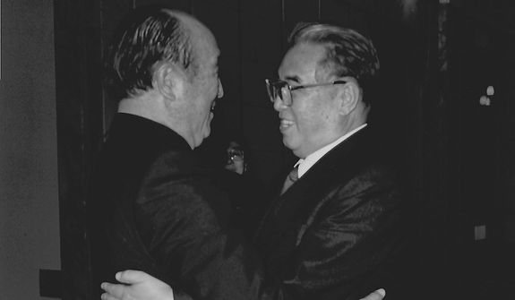 **FILE** The Rev. Sun Myung Moon hugs North Korean President Kim Il Sung. (Courtesy of H.S.A.-U.W.C.)