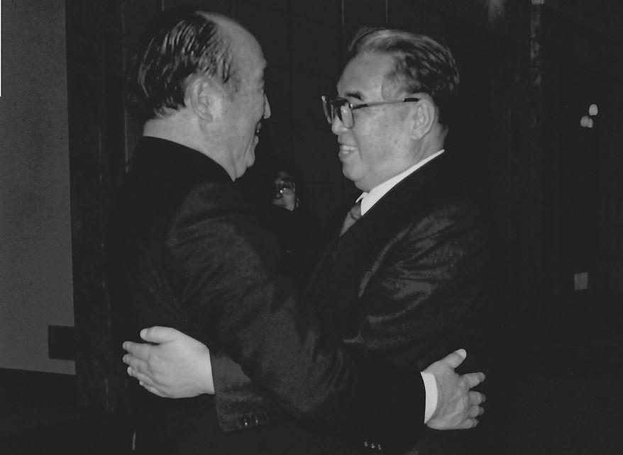 **FILE** The Rev. Sun Myung Moon hugs North Korean President Kim Il Sung. (Courtesy of H.S.A.-U.W.C.)