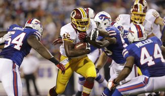 Washington Redskins' Alfred Morris (46) runs against the Buffalo Bills during the first half of a preseason NFL football game in Orchard Park, N.Y., Thursday, Aug. 9, 2012. (AP Photo/Gary Wiepert)
