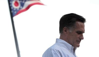 **FILE ** The Ohio flag flies in the background as Republican presidential candidate Mitt Romney speaks during a campaign event at the Ross County Courthouse in Chillicothe, Ohio, on Tuesday, Aug. 14, 2012. (AP Photo/Mary Altaffer)