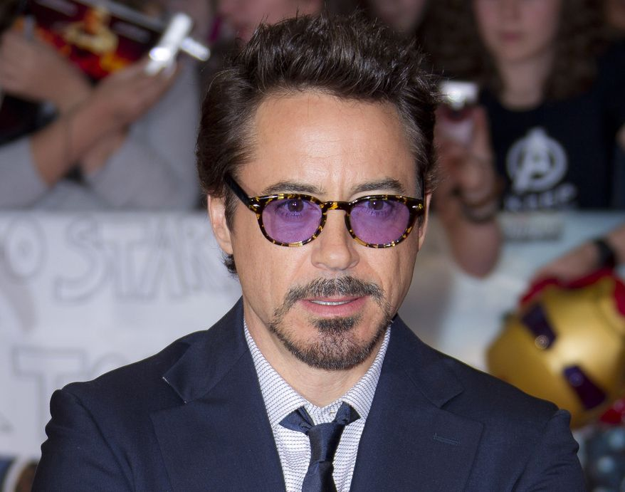 "** FILE ** In this April 19, 2012, file photo, actor Robert Downey Jr. arrives for the European Premiere of ""The Avengers,"" in London. Representatives at Marvel Entertainment announced that Downey Jr. sustained an injury to his foot while performing a stunt on the set of ""Iron Man 3."" (AP Photo/Joel Ryan, file)"