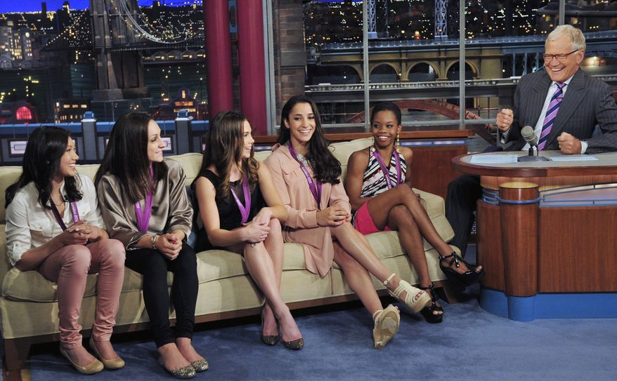 "In this photo provided by CBS, from left, Kyla Ross, Jordyn Wieber, McKayla Maroney, Aly Raisman and Gabby Douglas, members of the United States women's Olympic gymnastics gold medal-winning team, join television show host David Letterman on the set of the ""Late Show with David Letterman,"" Tuesday, Aug. 14, 2012, in New York. (AP Photo/CBS, John Paul Filo) MANDATORY CREDIT; NO SALES; NO ARCHIVE; FOR NORTH AMERICAN USE ONLY"