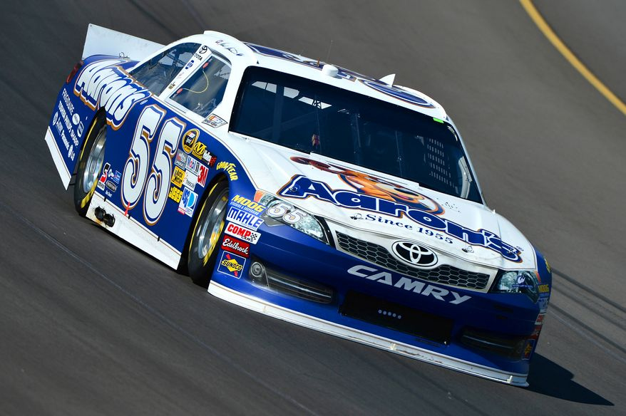 Mark Martin drives through turn one during practice for the NASCAR Sprint Cup Series auto race at Michigan International Speedway on Friday, Aug. 17, 2012 in Brooklyn Mich.. (AP Photo/Autostock, Brian Czobat)