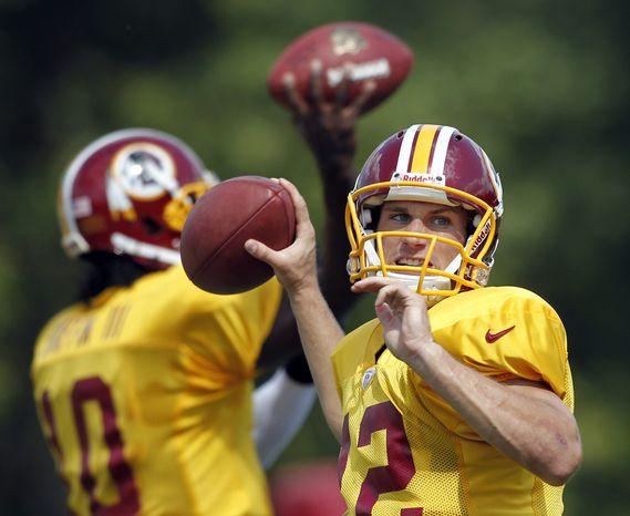 Washington Redskins quarterback Kirk Cousins throws Aug. 13, 2012, during training camp at Redskins Park in Ashburn, Va. (Associated Press)