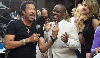 "Lionel Richie, left, sings with Al Roker and Savannah Guthrie while performing on NBC's ""Today"" show on Thursday, Aug. 16, 2012, in New York. (Photo by Charles Sykes/Invision/AP)"
