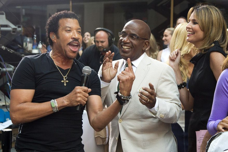 """Lionel Richie, left, sings with Al Roker and Savannah Guthrie while performing on NBC's """"Today"""" show on Thursday, Aug. 16, 2012, in New York. (Photo by Charles Sykes/Invision/AP)"""