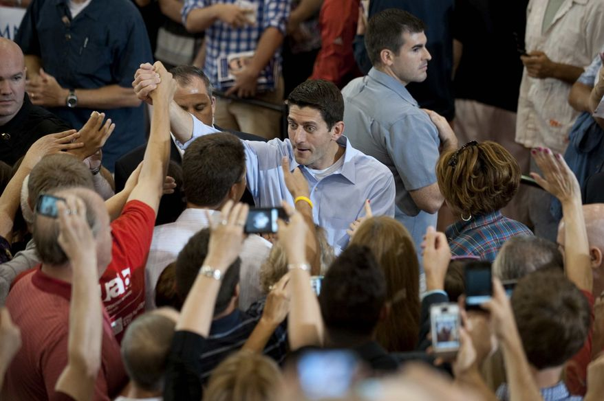 ** FILE ** Republican vice presidential candidate, Rep. Paul Ryan, R-Wis., greets supporters at Walsh University in North Canton, Ohio, Thursday, Aug. 16, 2012. (AP Photo/Tribune Review, Justin Merriman)