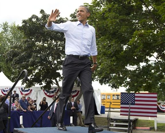 President Barack Obama arrives at a campaign event, Saturday, Aug. 18, 2012, in Rochester, N.H., at Rochester Commons. (AP Photo/Carolyn Kaster)