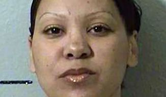 In this March 11, 2012, photo provided by the California Department of Corrections is Sara Kruzan. Kruzan was a teenage prostitute in 1994 when she shot and killed her 33-year-old pimp in the honeymoon suite of the Dynasty Suites Motel in Riverside. (AP Photo/California Department of Corrections)