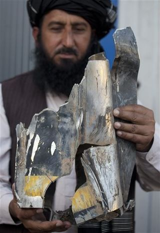 ** FILE ** In this Thursday, Oct. 27, 2011, file photo, Pakistani tribal elder Karim Khan shows the remains of a missile reportedly fired by a U.S. drone on a village in north Waziristan, killing many people, after his news conference in Islamabad, Pakistan. (AP Photo/B.K. Bangash)