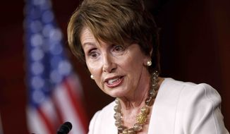 ** FILE ** In this July 26, 2012, file photo, House Minority Leader Nancy Pelosi of California meets with reporters on Capitol Hill in Washington. (AP Photo/J. Scott Applewhite, File)