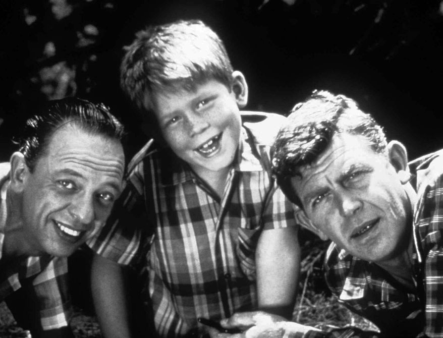 Mayberry was home to (from left) Don Knotts as Deputy Barney Fife, Ron Howard as Opie Taylor and Andy Griffith as Sheriff Andy Taylor in the 1960s. (Viacom via Associated Press)