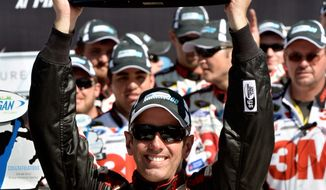 Greg Biffle celebrates Aug. 19, 2012, in Victory Lane after winning the Pure Michigan 400 Race auto race at Michigan International Speedway in Brooklyn Mich. (Associated Press/Autostock)