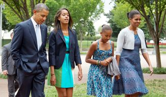 President Obama, first lady Michelle Obama and their daughters, Sasha and Malia, walk from the White House to attend services at a nearby church on Sunday. The president and Mitt Romney are facing off over Medicare on the campaign trail. (Associated Press)