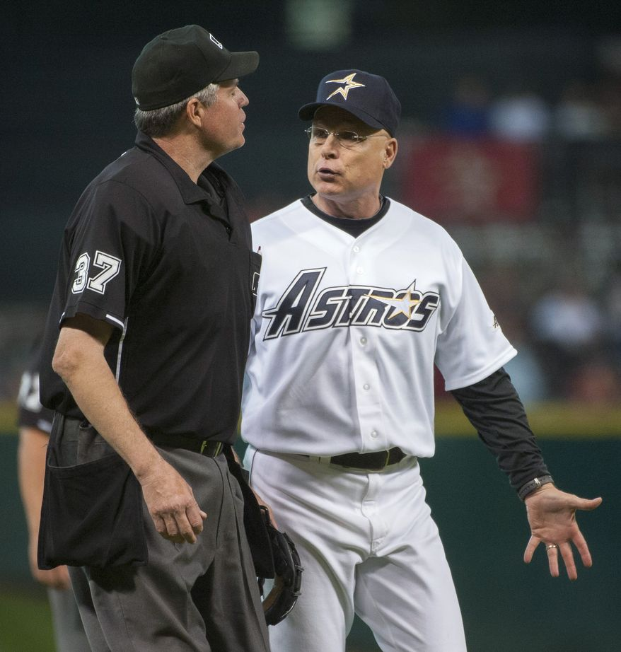 ** FILE ** Houston Astros manager Brad Mills (right) discusses a call with umpire Gary Darling during the third inning of a baseball game against the Milwaukee Brewers on Saturday, Aug. 11, 2012, in Houston. (AP Photo/Dave Einsel)